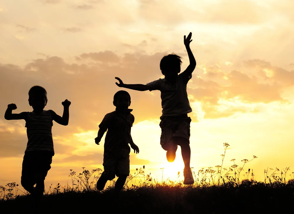 Children Running On Meadow At Sunset 1